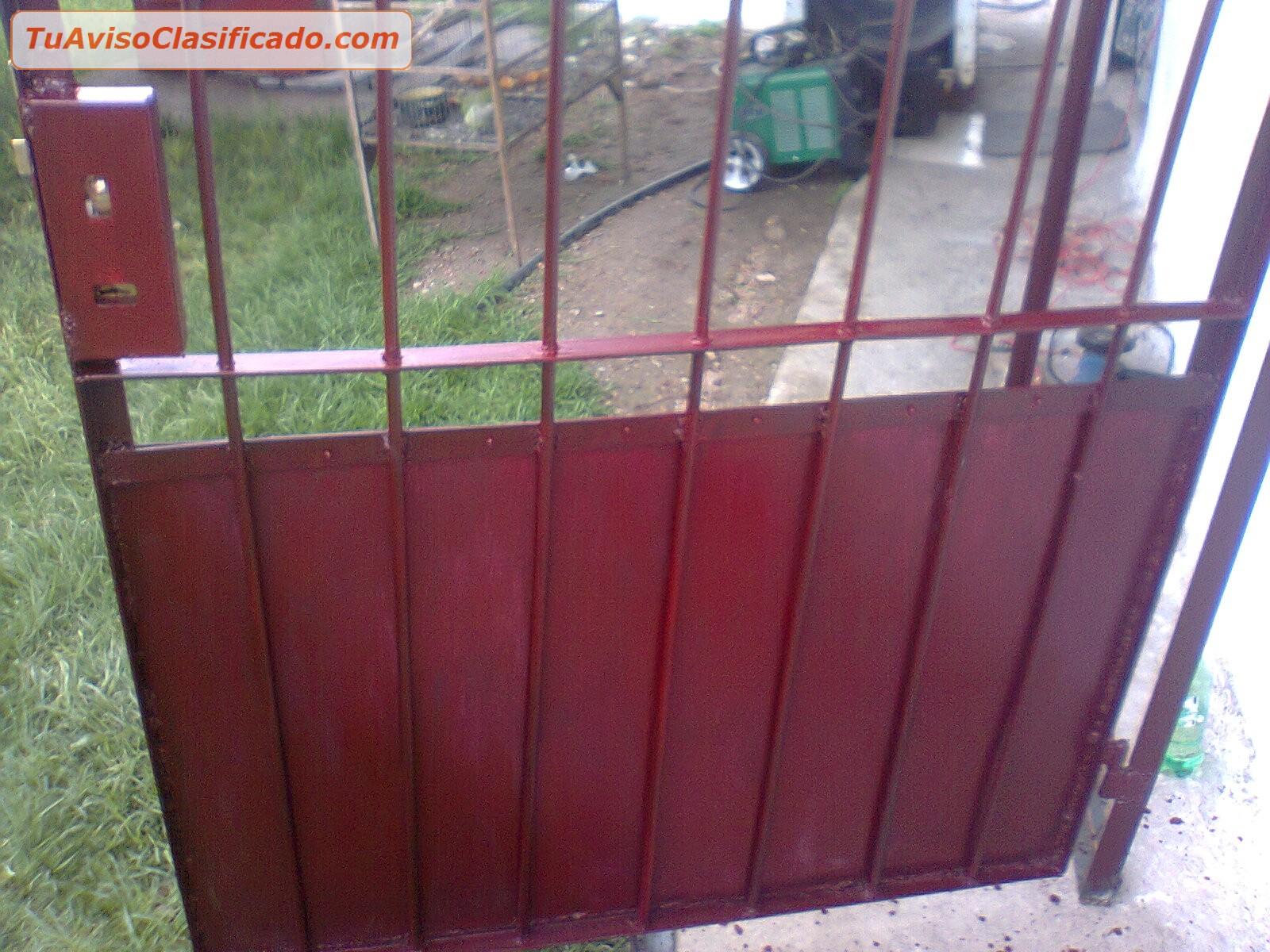 Herrero repara portones de chapa hierro empresas e for Puertas de chapa para exterior